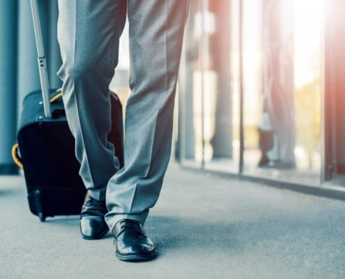 Business person showing only legs walking